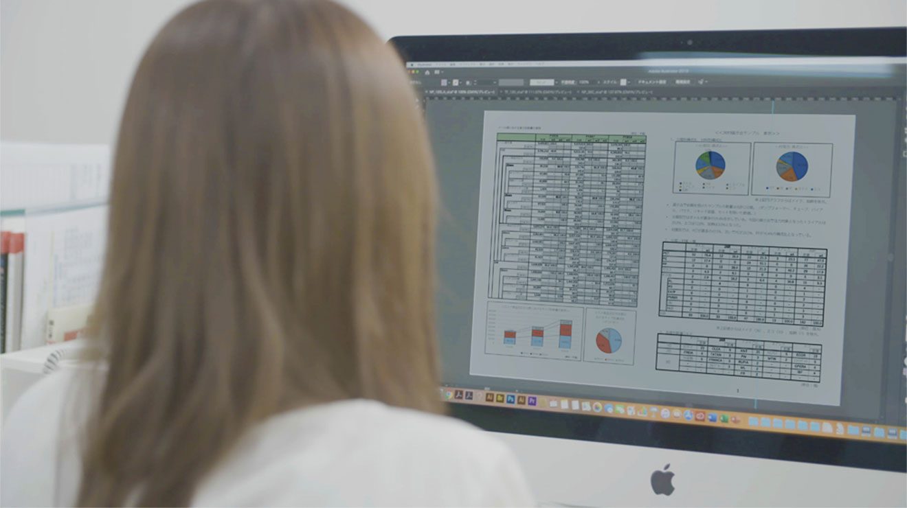 A woman looking at a computer monitor and analyzing it